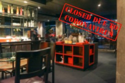 Defocused, blurred view of interior of an upmarket bar or restaurant, empty and closed due to coronavirus or covid 19 pandemics