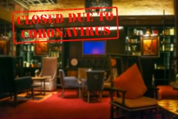 Defocused, blurred view of interior of an upmarket cafeteria or coffee shop, empty and closed due to coronavirus or covid 19 pandemics