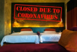 Defocused, blurred view of interior of an upmarket hotel or motel room, empty and closed due to coronavirus or covid 19 pandemics