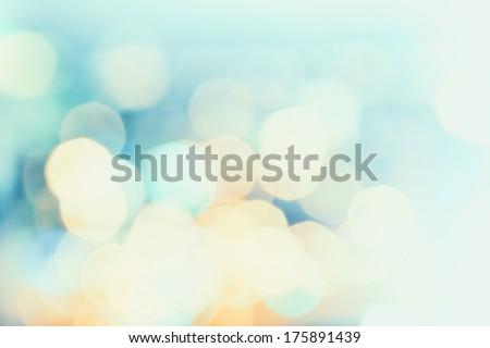 Defocused Bokeh twinkling lights Vintage background. Festive background with natural bokeh and bright golden lights.