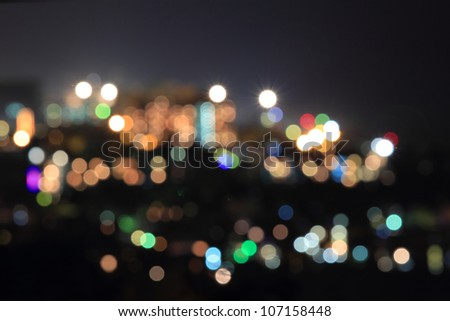 defocused city with lights of different colors in the night