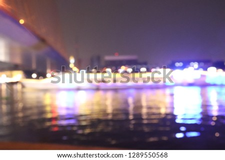 Defocused Cityscape Riverside  at Night Light Background #1289550568