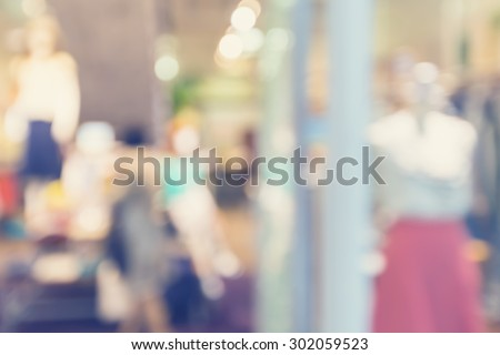Defocused clothing store front entrance displaying woman\'s fashion