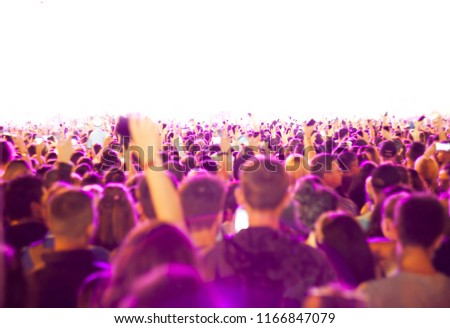 defocused crowd of people at a night concert or show. white background #1166847079