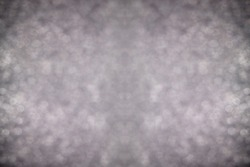 Defocused dust particles in the air. Bokeh. Double symmetrical image of mirror halves. Monotone background.