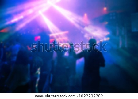Defocused entertainment concert lighting on stage, blurred disco party. #1022292202