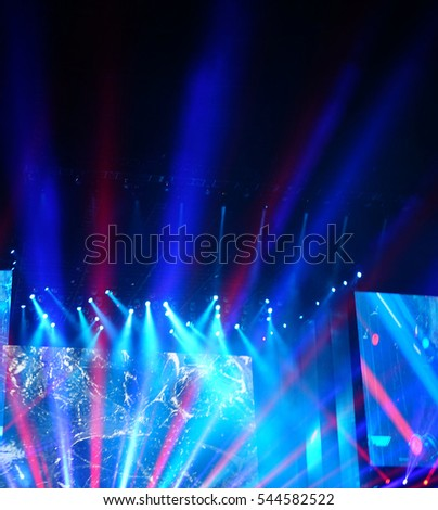 Defocused entertainment concert lighting on stage, blurred disco party. #544582522