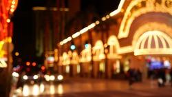 Defocused fabulous Las Vegas Strip boulevard, luxury casino and hotel, gambling area in Nevada, USA. Nightlife and traffic near Fremont street in tourist money playing resort. Neon lights of sin city.