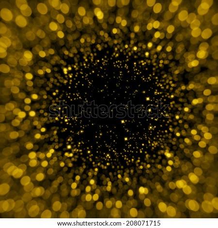 Defocused gold sparkle glitter lights background. Glitter bokeh background