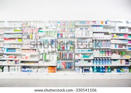 Defocused image of medicines arranged in shelves at pharmacy