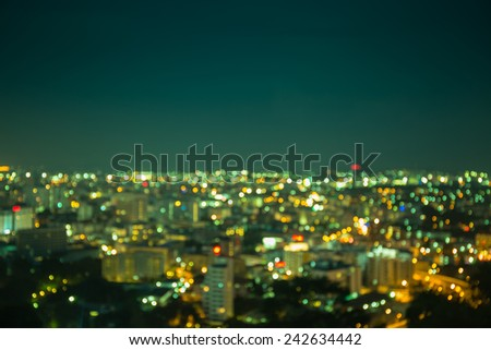 Defocused lights and building of big city in night time
