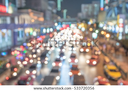 Defocused lights car traffic jam of a street road at night retro color effect for background