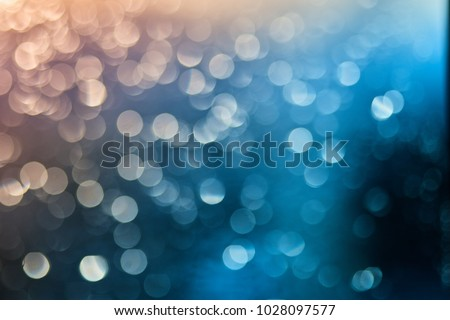 Defocused of light blue and orange LED light on black background. Bokeh photo of LED light. Blue and amber. Orange and teal Bokeh. Cold and warm blurred contrasted photo.