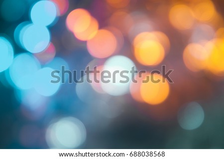 Defocused of light blue and yellow LED light on black background. Bokeh photo of LED light. Blue and yellow bokeh. Orange and teal Bokeh