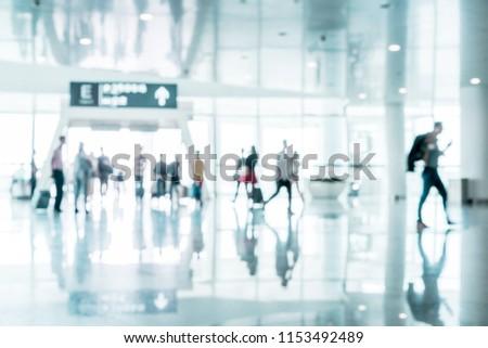 Defocused People Walking in Airport Terminal #1153492489