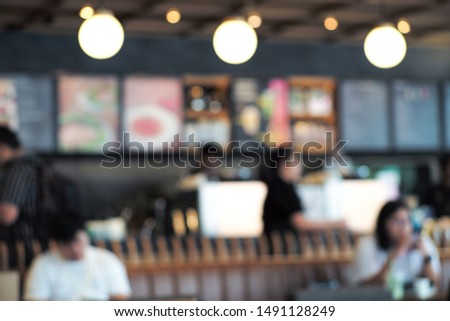 Defocused perpective of coffee shop with people. Blurred decorative lights inside co working space with bar in background #1491128249