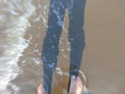 Defocused sahdow of man with wave beach image.