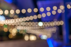 Defocused scene in the street with bokeh lights