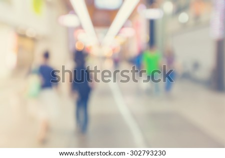 Defocused shopping mall interior with groups of people walking  #302793230