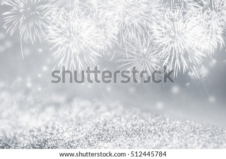 Defocused silver and gray fireworks and bokeh on gliter paper at New Year and copy space. Abstract background holiday. #512445784