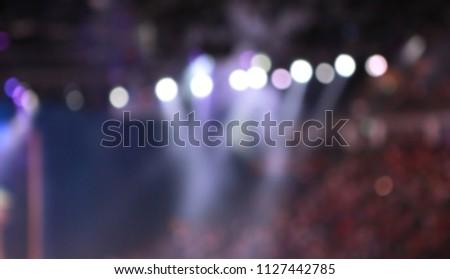 Defocused Spotlights with fog on stage. #1127442785