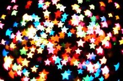Defocused star bokeh on christmas light