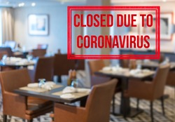 Defocused view of interior of an upmarket restaurant empty and closed due to coronavirus or covid-19