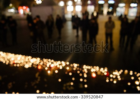 Defocused view of people attend a vigil and light candles in the center of Strasbourg for the victims of the November 13 attacks in Paris that killed at least 128 people