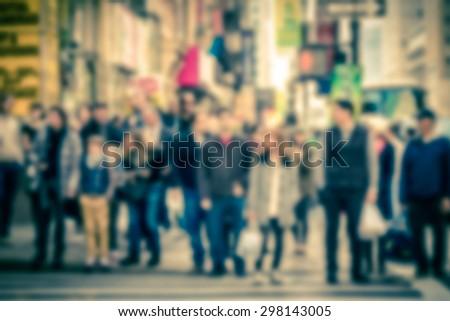 Defocused vintage toned pedestrians at crosswalk intersection in Manhattan New York City
