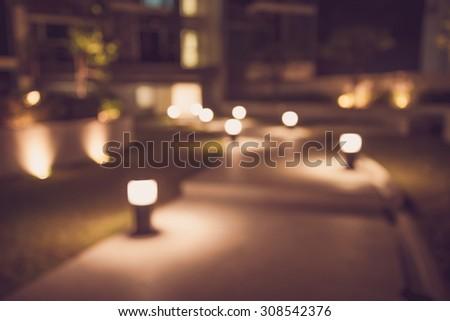 Defocused walkway in night garden background - Color tone effect
