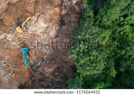 Deforestation aerial photo. Rainforest jungle in construction road site