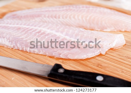Defrosted raw fish fillets closeup