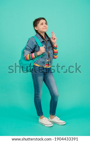 Defy Superstition Day. Superstitious child with crossed fingers. Small girl make wish blue background. Crossing fingers for luck. Victim of superstition. Friday 13th. World is full of superstitions. Photo stock ©