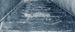 Degraded and Grungy Cement Stairs Heading Down From Pier
