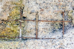 Degraded concrete and rusted, exposed rebars or bars. The expansion of the corrosion products (iron oxides) of carbon steel reinforcement structures may induce mechanical stress.