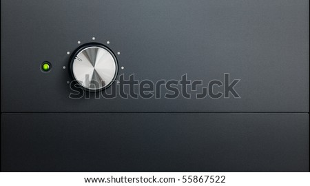 stock photo : degrading black surface of amplifier with one knob and green ...