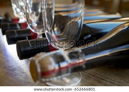 degustation of red wine in a cellar with glass flutes #652666801
