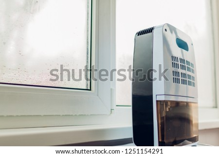 Dehumidifier with touch panel, humidity indicator, uv lamp, air ionizer, water container works by wet window.