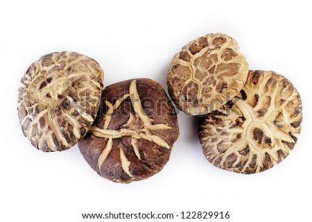 Dehydrated Shitake mushrooms on white background