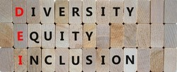 DEI, Diversity, equity, inclusion symbol. Wooden blocks with words DEI, diversity, equity, inclusion on beautiful wooden background. Business, DEI, diversity, equity, inclusion concept.