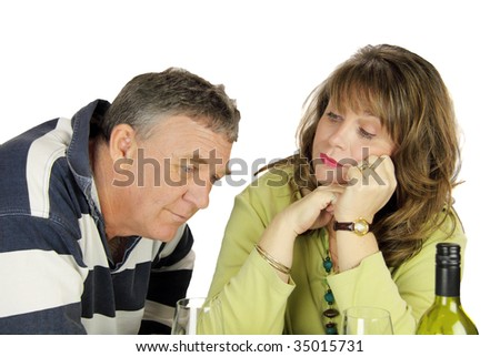 Dejected middle aged couple after having had an argument. - stock photo