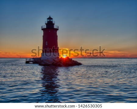 Delaware's Breakwater East End Lighthouse is no longer operational but remains an impressive landmark in Lewes, Delaware and even more so at sunset. Zdjęcia stock ©