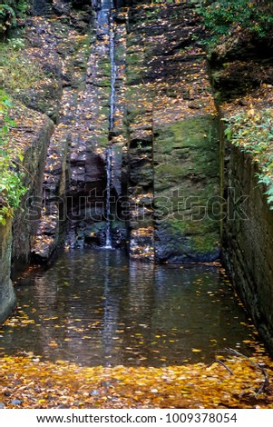 Delaware Township, Pike County, Pennsylvania, USA: Autumn foliage surrounds Silverthread Falls, in Dingmans Ferry in the Delaware Water Gap National Recreation Area.