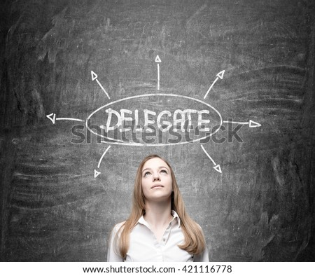 Delegating concept with thoughtful businesswoman on chalkboard background