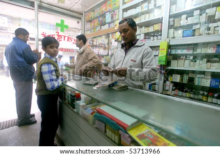 DELHI - FEB 2008. Pharmacy assistant selling medicine to customers on February 12, 2008 in Delhi, India. 80% of medicine revenue comes from international markets and just 20% from India.
