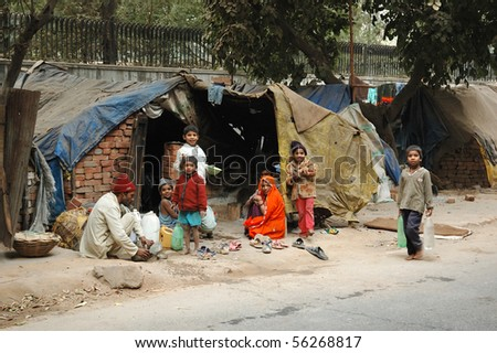 DELHI,INDIA - DECEMBER 12: Poor family at slum area December 12, 2008 in Delhi,India. Millions people of India doesn't have normal housing because of overcrowding problem