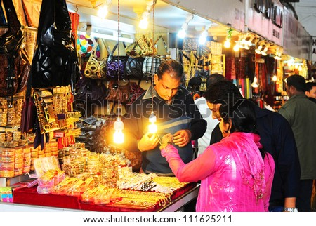 DELHI, INDIA - FEB 02: People at a gift market in Red Fort on  Feb 02, 2012 in Delhi. The Red Fort  was designated a UNESCO World Heritage Site in 2007. It covers a total area of about 122 acres