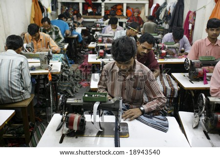 Delhi, India - Feb 2008. Textile workers in a small factory in Old Delhi. Contributing  to India's growing economy.