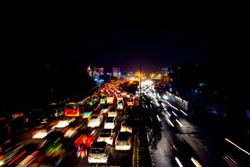 Delhi, India. Heavy car traffic in the city center of Delhi, India at night. Illuminated car trails