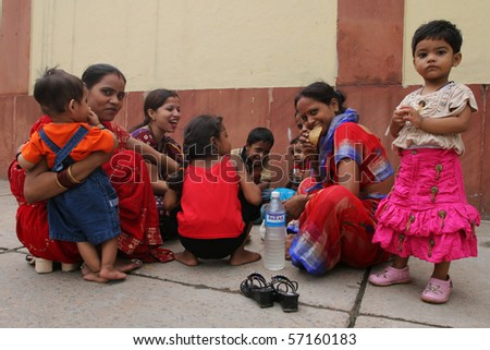 DELHI, INDIA - JULY 31: Indian women and children sitting on a street July 31, 2008 in Delhi, India